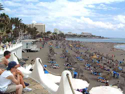 Tenerife information -Photograph Beach and Sea front at Playa de la Troya Buildings of Playa de las Americas in the background
